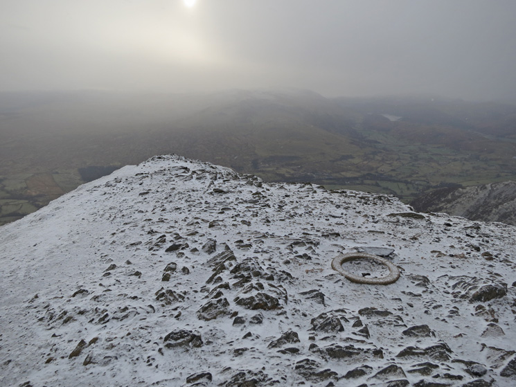 South from Blencathra's summit with its circular stone trig station