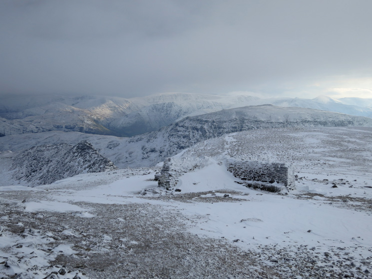 Helvellyn's cross shelter with St Sunday Crag behind