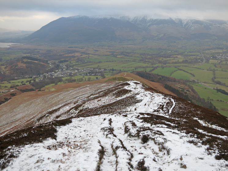 Looking back down Barrow's north ridge with the top of the Skiddaw fells in cloud