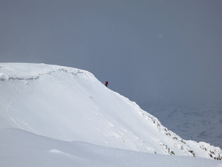 A climber nears the summit having ascended via Swirral Edge