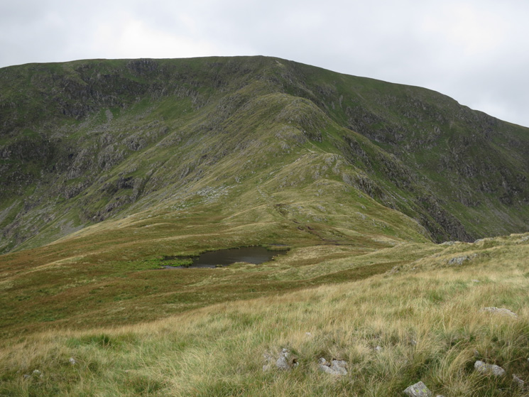Caspel Gate Tarn and Long Stile leading to High Street's summit
