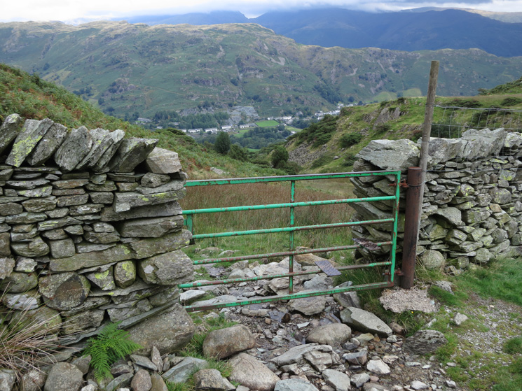 You reach the ridge just after climbing this gate. Chapel Stile far below